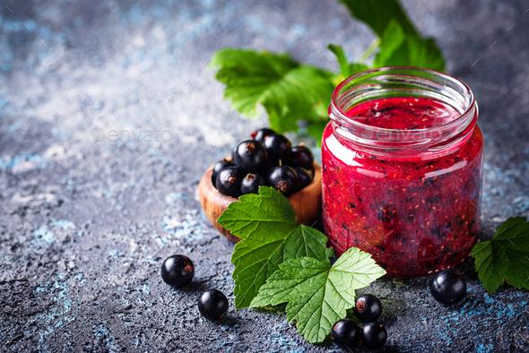 Black currant jam in jar - Stock Photo - Images