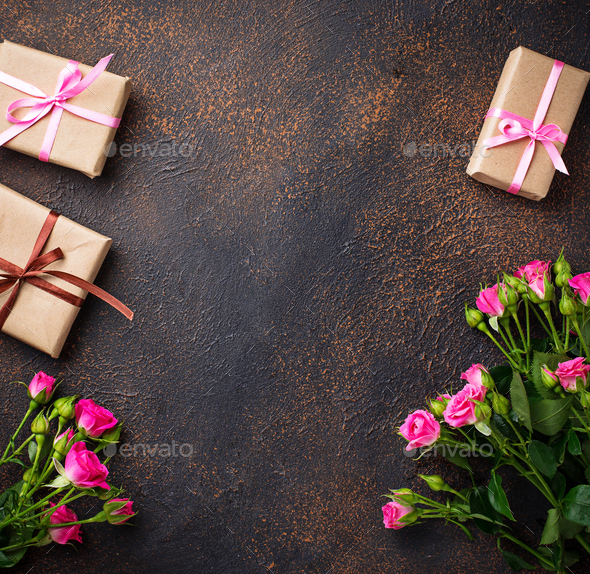 Pink roses and gift boxes with ribbons - Stock Photo - Images