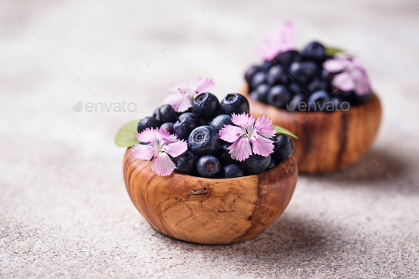 Fresh ripe blueberries in wooden bowl - Stock Photo - Images