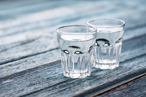 Glasses and jug of cold water - Stock Photo - Images