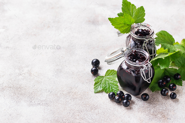 Black currant jam in jar - Stock Photo - Images