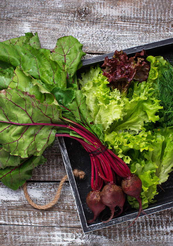 Beetroots, lettuce and parsley in wooden box - Stock Photo - Images