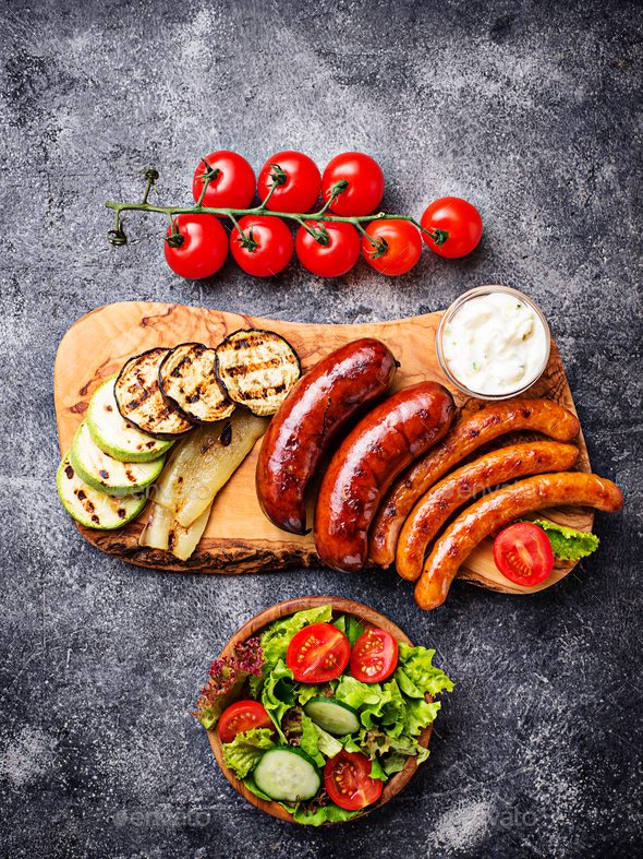 Assortment of grilled sausages and vegetables - Stock Photo - Images