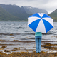 Woman under an umbrella in the background of nature Norway - PhotoDune Item for Sale