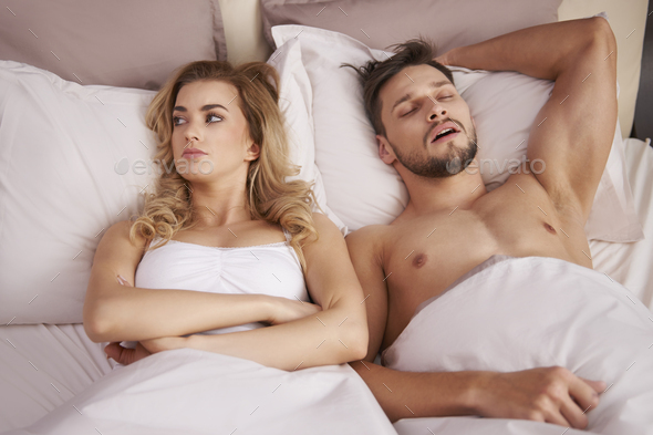His snoring goes beyond a joke - Stock Photo - Images