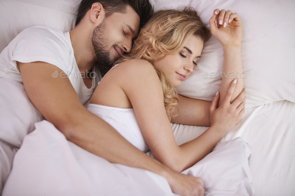 Sleeping couple in the comfortable bed - Stock Photo - Images