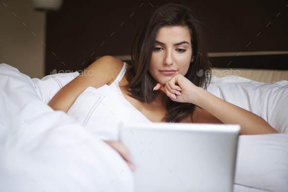 Staying online even in bed - Stock Photo - Images