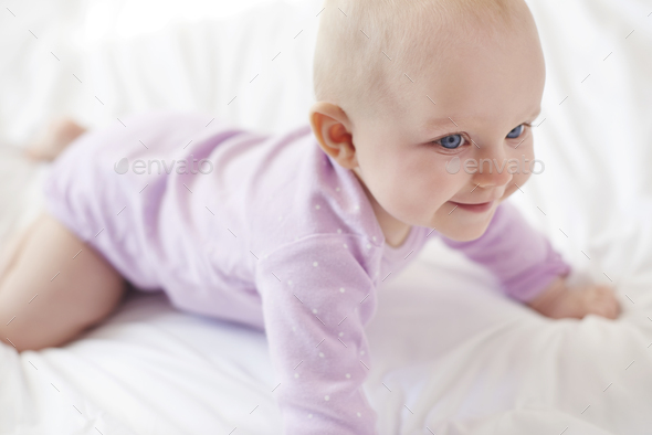 Strong cute little girl start crawling - Stock Photo - Images