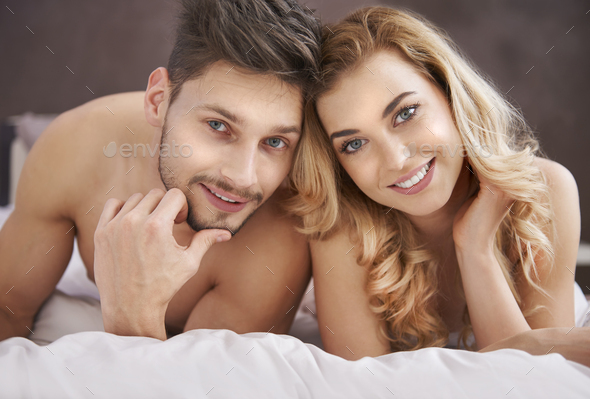 Portrait of couple in the bed - Stock Photo - Images