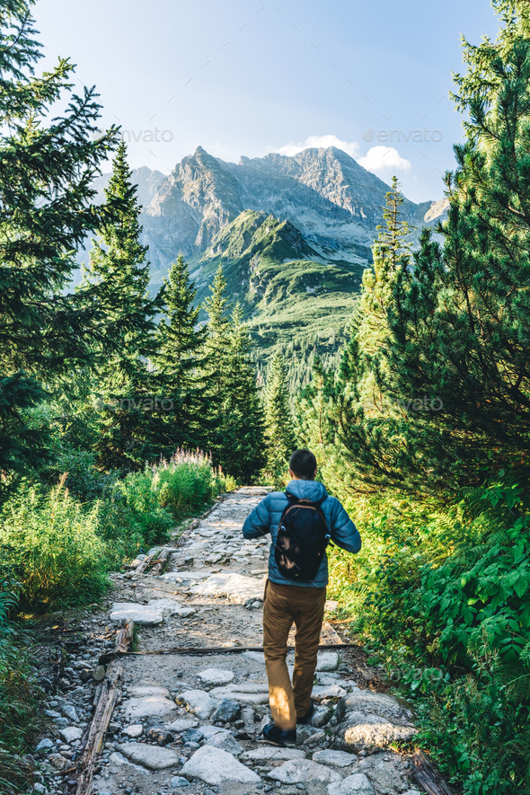 Man walking on hiking trail in Tatra mountains in Poland - Stock Photo - Images