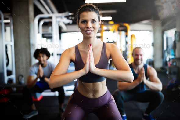 Beautiful fit people working out in gym together - Stock Photo - Images