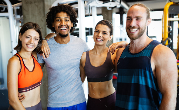 Group of young people doing exercises in gym - Stock Photo - Images