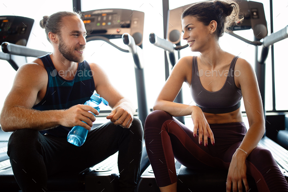 Happy fit friends exercising, working out in gym to stay healthy together - Stock Photo - Images