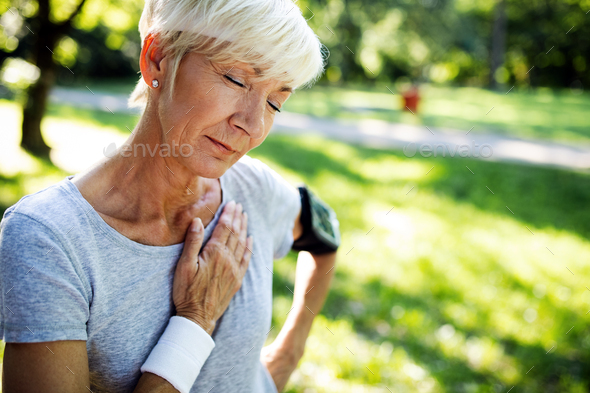 Mature woman exercising outdoors to prevent cardiovascular diseases and heart attack - Stock Photo - Images