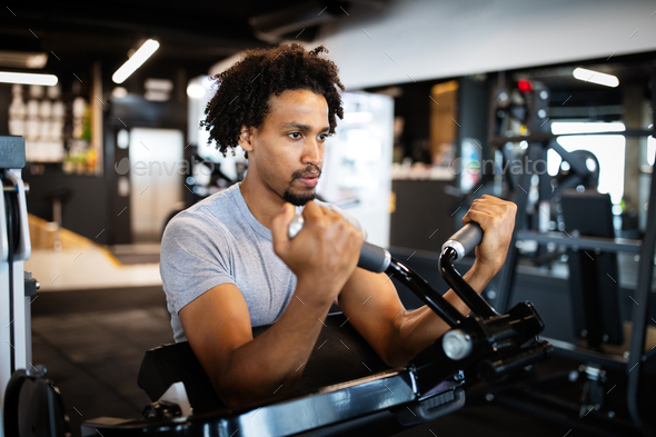 Young fit man working out in the gym - Stock Photo - Images