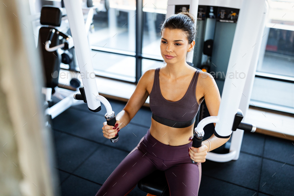 Close up image of attractive fit woman in gym - Stock Photo - Images