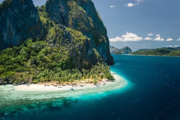 Unique beauty of tropical Pinagbuyutan Island and white sand ipil beach in blue ocean El Nido - Stock Photo - Images