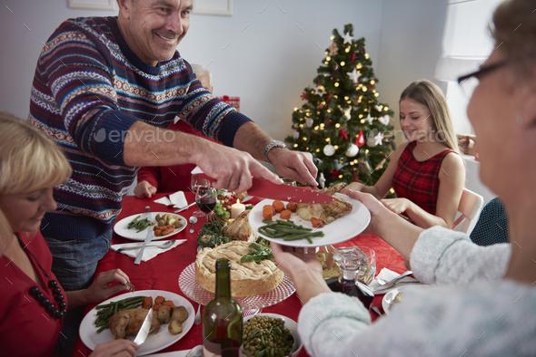 Celebrating christmas eve with family - Stock Photo - Images