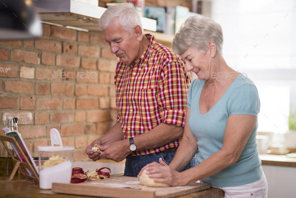 Homemade apple pie baked by a senior couple - Stock Photo - Images