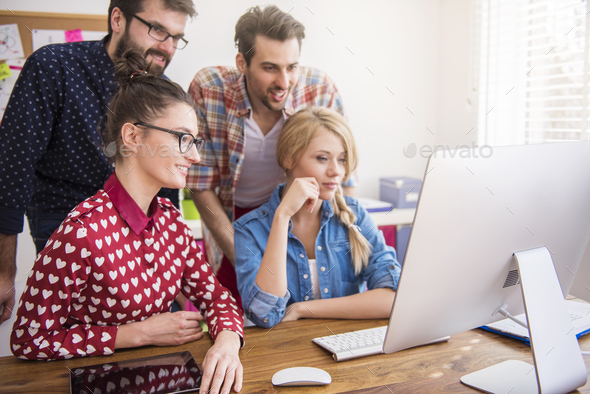 Colleagues working on great project together - Stock Photo - Images