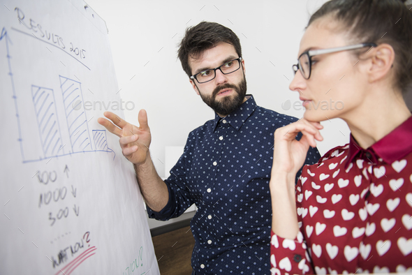 Colleagues checking results from the past year - Stock Photo - Images