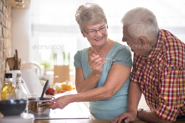 Lots of fun during cooking together - Stock Photo - Images