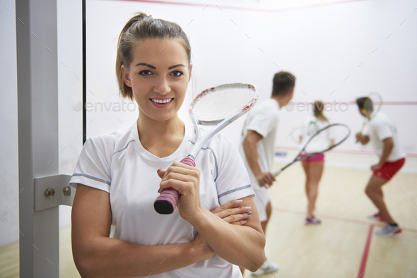 Squash player and people in the background - Stock Photo - Images