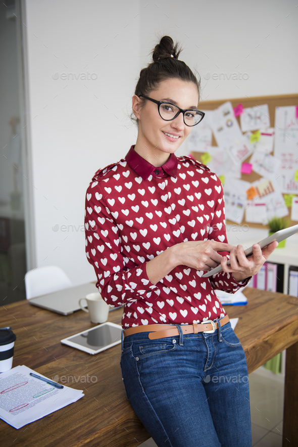 Attractive woman working on her tablet - Stock Photo - Images