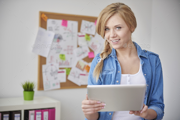New technology in her job is necessary - Stock Photo - Images