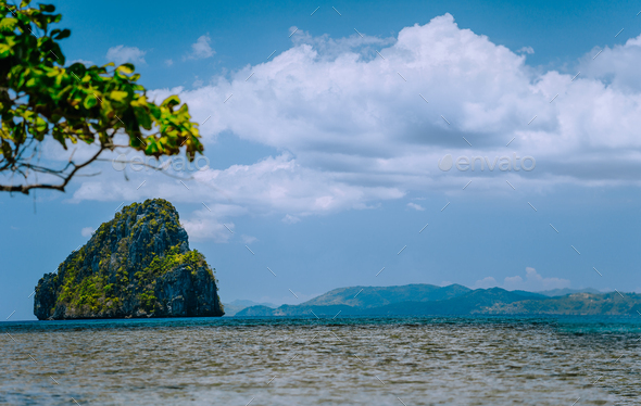 El Nido, Palawan, Philippines. Tropical rocky island in open ocean and cloudscape - Stock Photo - Images