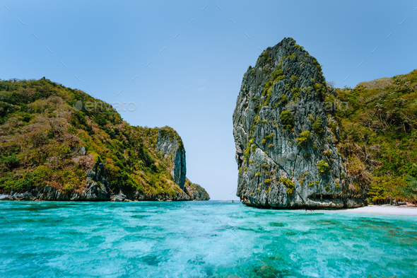 El Nido, Palawan, Philippines. Aerial view of towering cliffs in front of tropical Island with white - Stock Photo - Images