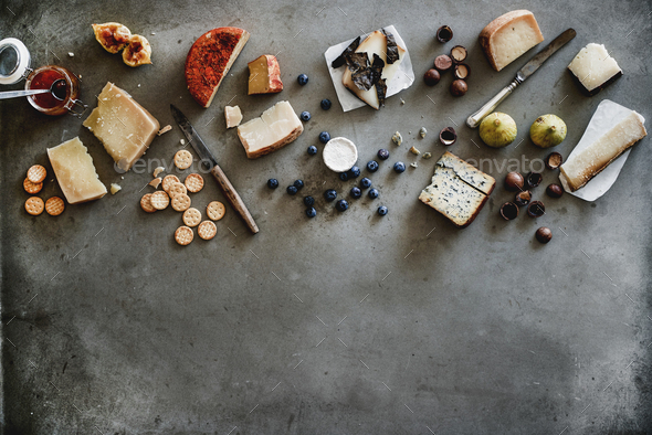 Variety of wine snacks, jam and cheeses over grey background - Stock Photo - Images