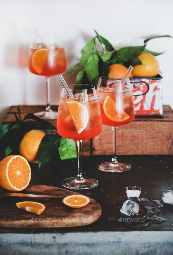 Aperol Spritz aperitif drink in glasses with oranges and ice - Stock Photo - Images