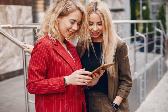 Two businesswomen working in a cafe - Stock Photo - Images