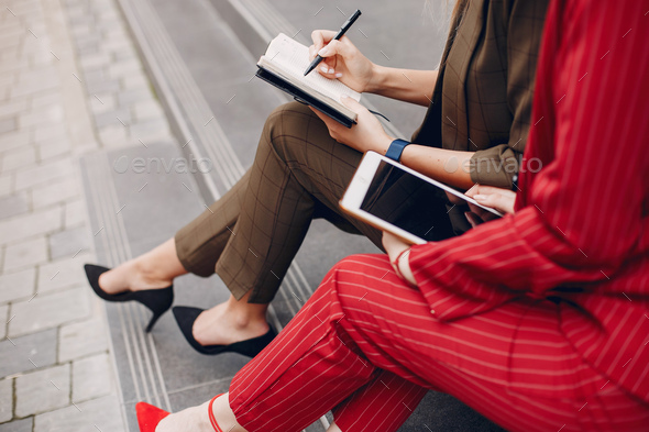 Two businesswomen working in a city - Stock Photo - Images