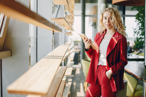 Elegant businesswoman working in a office - Stock Photo - Images