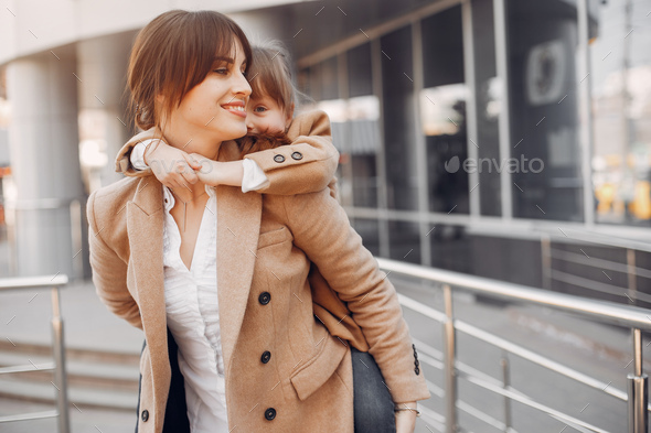 Mother and daughter with shopping bag in a city - Stock Photo - Images
