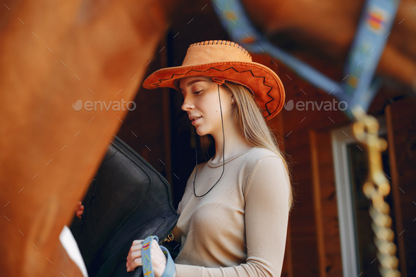Beautiful woman standing with a horse - Stock Photo - Images