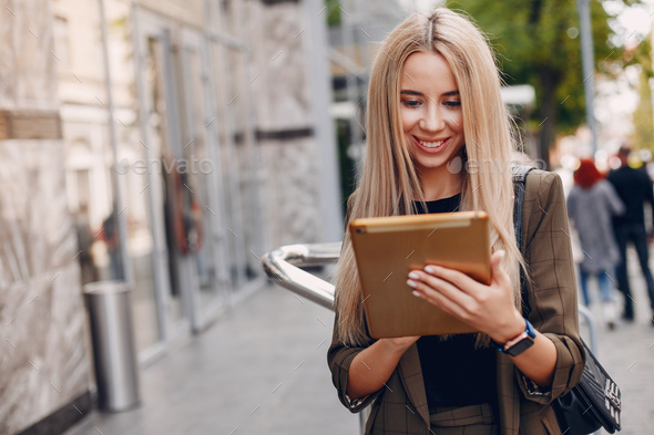 Elegant businesswoman working in a city - Stock Photo - Images