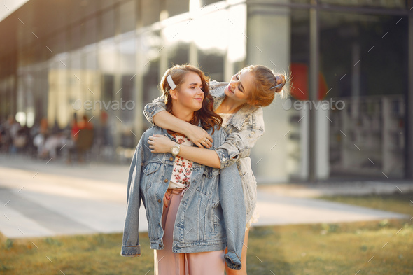 Elegant and stylish girls in a summer park - Stock Photo - Images
