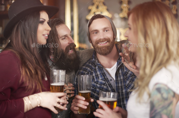 Group of people drinking beer in the pub - Stock Photo - Images