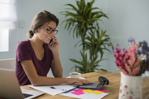 Busy accountant working at home - Stock Photo - Images