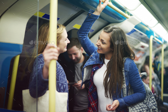 Meeting old friends in the subway - Stock Photo - Images