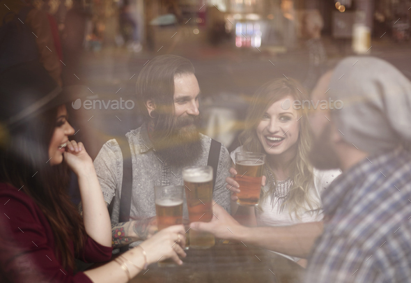 Sip of cold beer after work - Stock Photo - Images