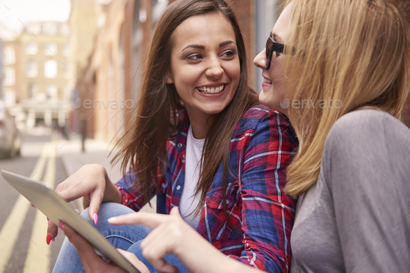 Best friends having a break with Touch pad - Stock Photo - Images
