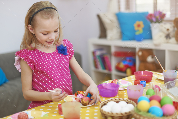 Little girl and her Easter eggs - Stock Photo - Images