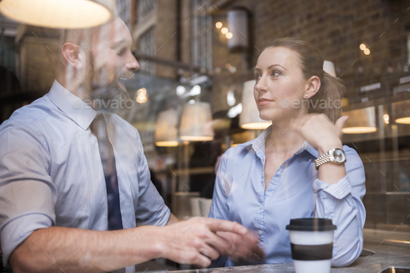 Business meeting at popular cafe - Stock Photo - Images