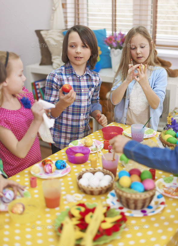 Painting Easter eggs with friends - Stock Photo - Images