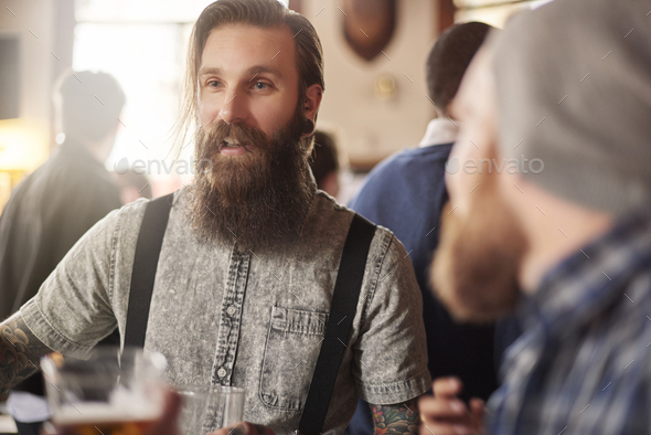 Man catches attention of his friends - Stock Photo - Images