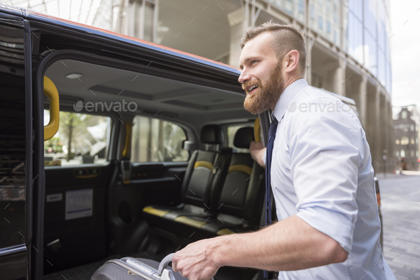 He's starting a business travel - Stock Photo - Images